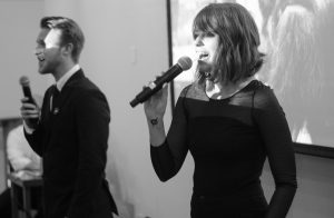 Edward Odom and Katy Manning emceeing the What It's Like Project's Black White Gala