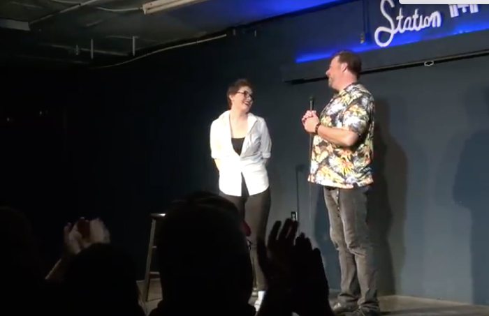 Comedians Alycia Rose Quacker and Scott White share a laugh together on the stage at Station Theater.